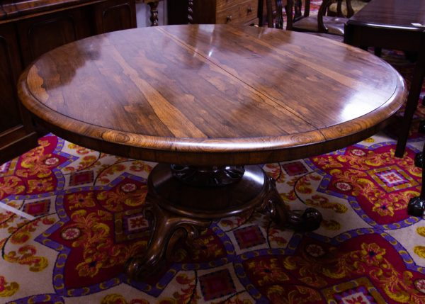 Antique round rosewood dining table on pod leg. Measures 130 diameter x 73H. Prices include nationwide delivery