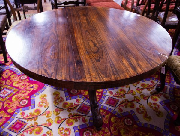 Round rosewood breakfast table on pod leg and brass castors. Measures 130 diameter x 74H. Prices include nationwide delivery