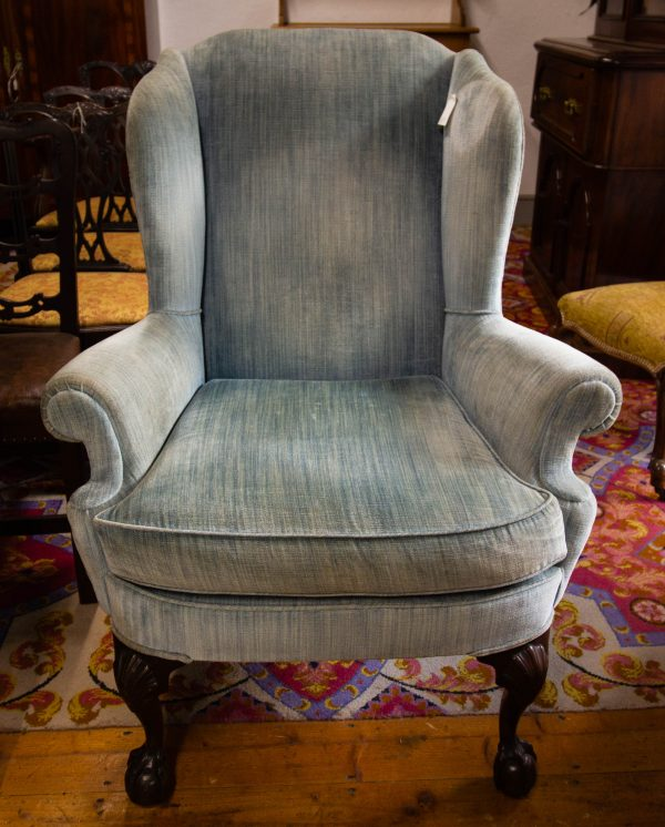 Large pale blue wing back armchair. Does have some marks on the fabric. Measures 90W x 80D x seat 53H, 114H back. Price includes nationwide delivery