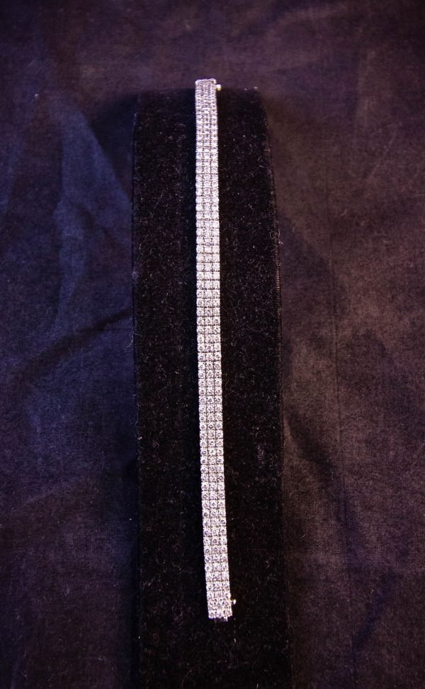 18k white gold and diamond triple line bracelet. Total diamond content 4ct. Price includes nationwide delivery.