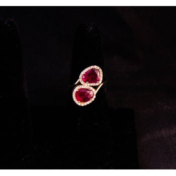18k yellow gold Toi et Moi engagement ring. Set with two rubies, totalling 1.61ct and surrounding diamonds, totalling .21ct. Size M. Price includes nationwide delivery.