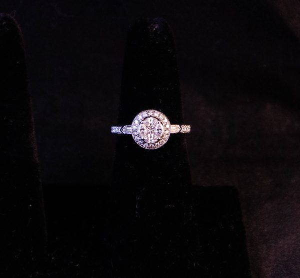 18k white gold and diamond cluster ring. Four marquis cut diamonds surround a princess cut centre diamond with baguette and round diamond shoulders. Total diamond .84ct, size L 1/2. Price includes nationwide delivery.