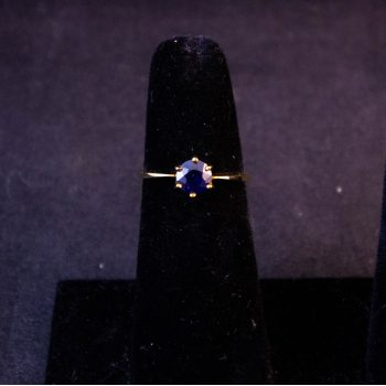 9k yellow gold ring with blue spinel stone in claw setting. Size K. Price includes nationwide delivery.