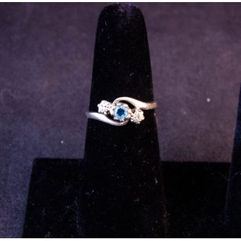 9k white gold ring with blue topaz and diamond stones. Size O. Price includes nationwide delivery.