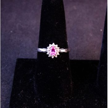 9k white gold ring with pink sapphire and diamond cluster. Size S. Price includes nationwide delivery