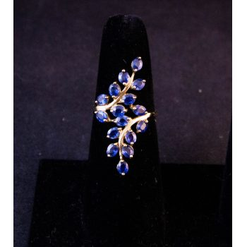 9k yellow gold and blue spinel crossover style leaf ring. Size N. Price includes nationwide delivery.