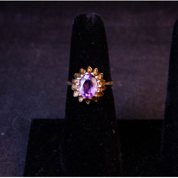 9k yellow gold ring with amethyst in claw setting. Size O. Price includes nationwide delivery.