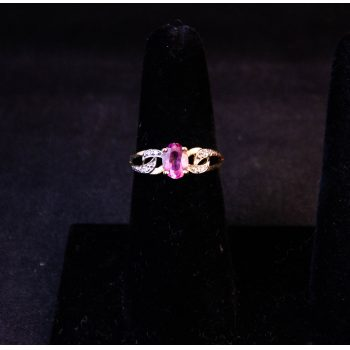 9k yellow gold pink sapphire dress ring. Size N Price includes nationwide delivery