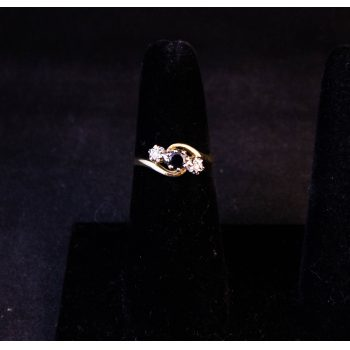 9k yellow gold, sapphire and diamond twist ring. Size M Price includes nationwide delivery.