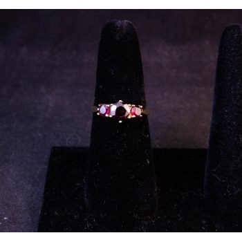 9k yellow gold three stone garnet dress ring. Size O Price includes nationwide delivery