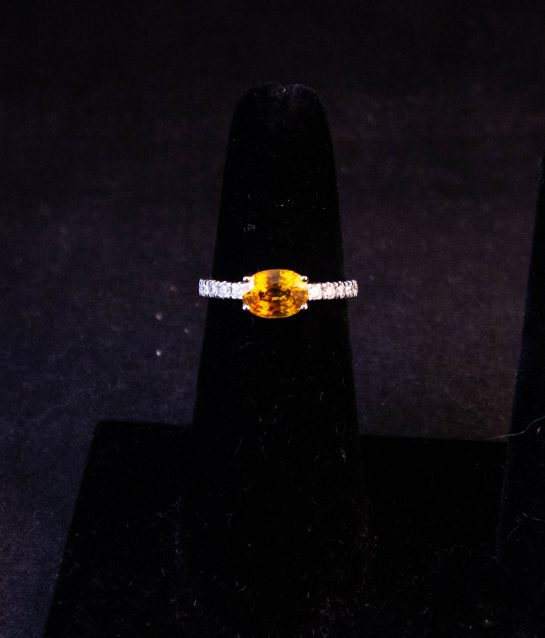 18k white gold ring with yellow sapphire solitaire and 18 diamonds in half eternity shoulders. Total sapphire content 1.28ct, total diamond content .45ct. Size M. Price includes nationwide delivery