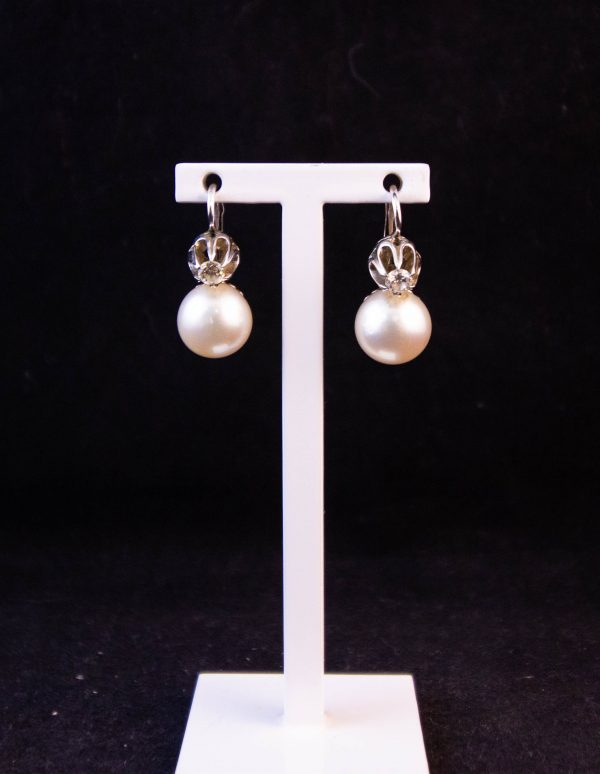 Pair of 18k white gold, diamond and pearl earrings. Total diamond content .2ct.  Price includes nationwide delivery