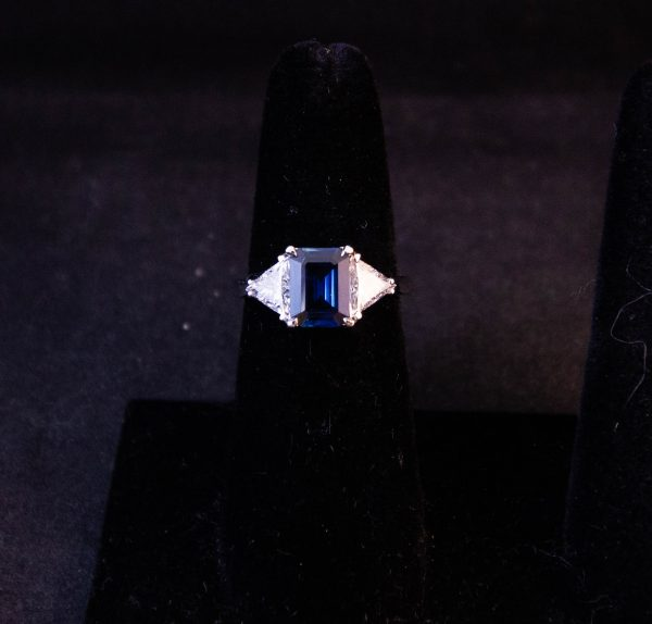 18k white gold ring with rectangular sapphire with triangular diamond shoulders. Total diamond content .76ct, total sapphire content 1.75ct. Size  Price includes nationwide delivery