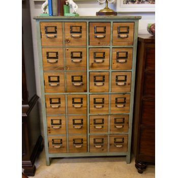 Industrial timber haberdashery style green cabinet with natural timber drawers. Contains two cabinet doors, 3 long drawers, and 6 small drawers. Measures 74W x 32D x 120H in cm. Price includes nationwide delivery