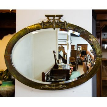 "Oval brass beveled mirror. Measures 34""L x 26.5""H"