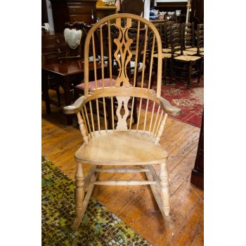 "Antique pine rocking chair. Measures 26""L x 34""D x 47""H"