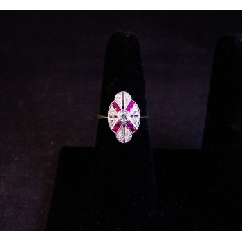 Art deco shield shaped ruby and diamond ring set in 18k gold. Size N1/2