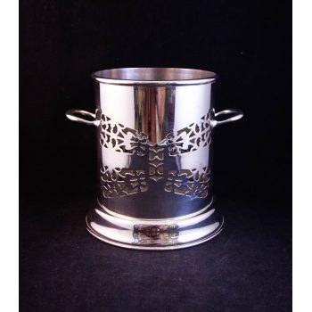 "Silver plated two handled bottle coaster. Measures 6""W x 5.75""H"
