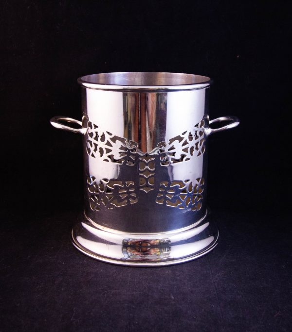 """Silver plated two handled bottle coaster. Measures 6""""W x 5.75""""H"""