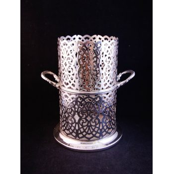 "Pierced silver plated two handled bottle coaster. Measures 7""W x 7.5""H"