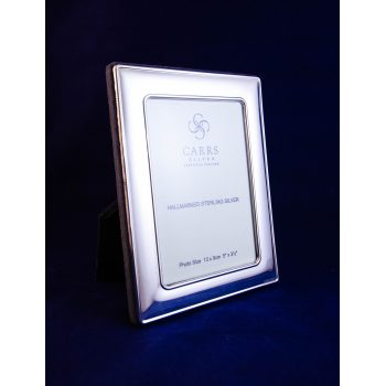 "Silver photo frame with velvet back. Photo size 3.5""W x 5""H, total size 5""W x 6.5""H"