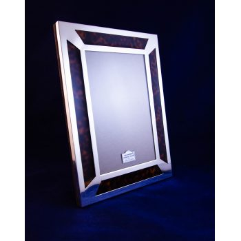 """Silver and faux tortoiseshell photo frame. Photo size measures 4""""W x 6""""H, total size measures 6.25""""W x 8.25""""H"""