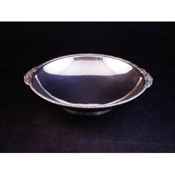Silver footed bowl with small handles. Stamped Birmingham 1934, weighing 368g. Measures 20cm diameter + 1cm each handle. Price includes nationwide delivery.