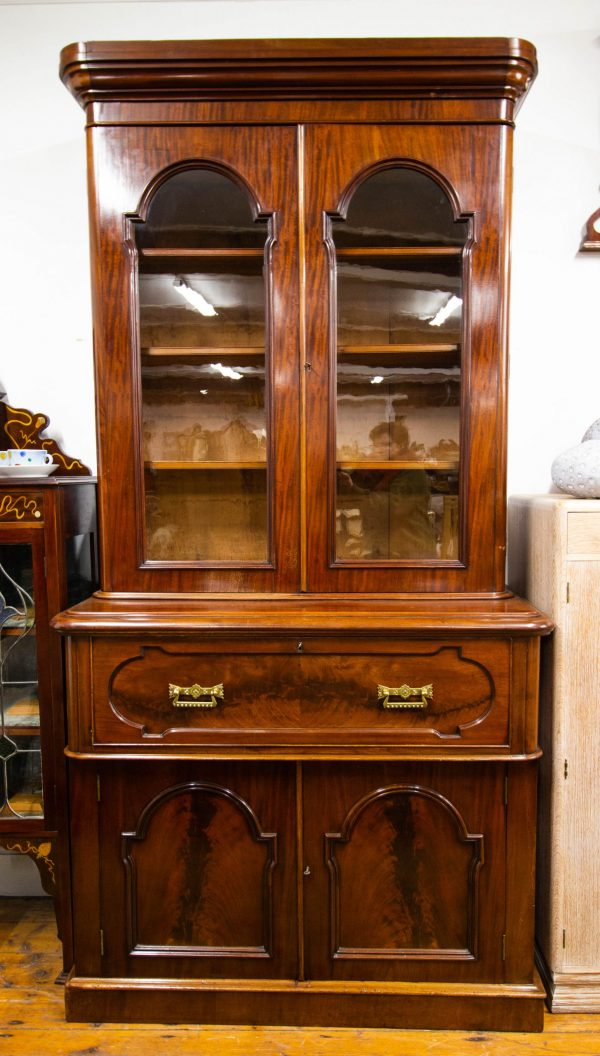 """Antique mahogany secretaire bookcase with leather writing top and brass fittings. Measures 48""""L x 23""""D x 96""""H"""