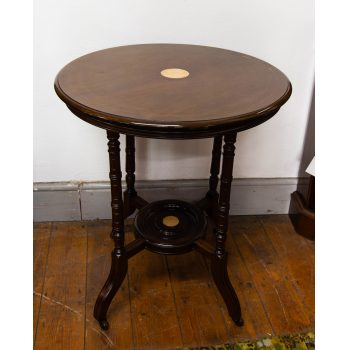 "Round inlaid occasional table on castors. Small repairs done by previous owners. Measures 25.5""W x 29.5""H"