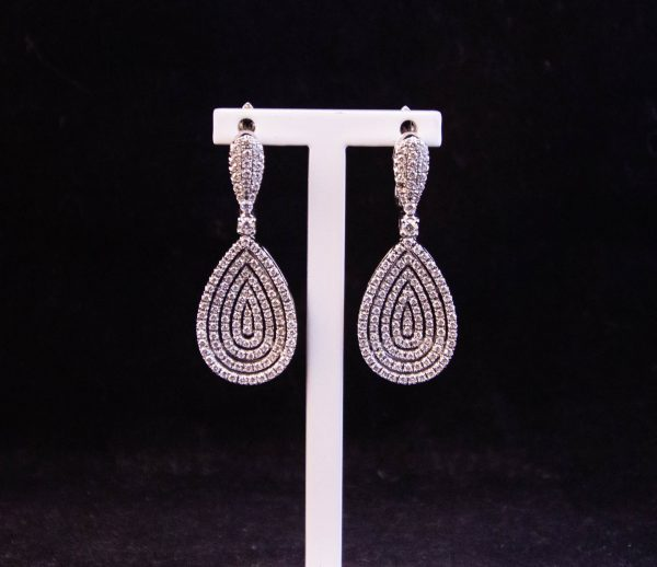 18k white gold + diamond pear shaped pendant earrings. Price includes nationwide delivery