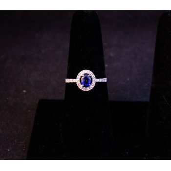 18k white gold, diamond and sapphire halo style ring with diamond shoulders. Total sapphire .62ct, total diamond .11ct. Size P 1/2. Price includes nationwide delivery.