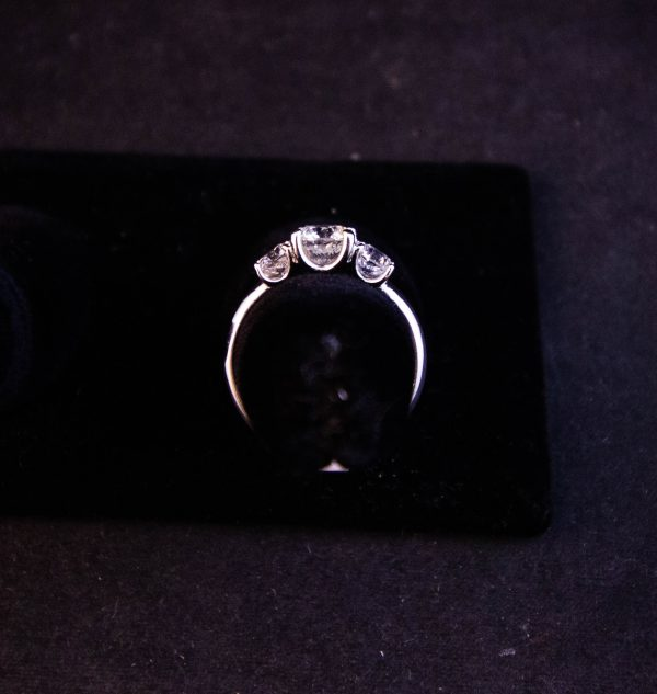 18k white gold three stone diamond ring. Centre diamond is 1.03ct, two side diamonds are .4ct each. Size N. Price includes nationwide delivery