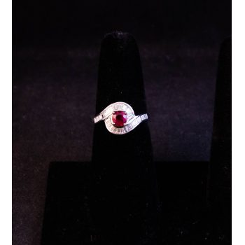 18k white gold ruby ring, surrounded by baguette cut diamonds. Total ruby 1.08ct, total diamond .86ct. Size N. Price includes nationwide delivery.