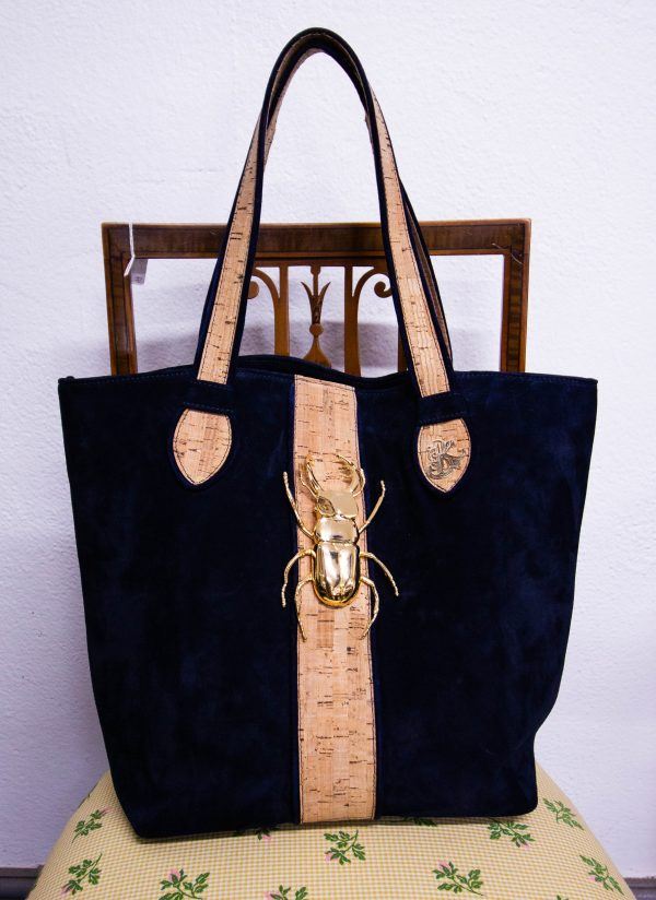 Villatrentuno navy suede tote bag with gilt stag beetle decoration. Bag has zip closure on main pocket and inside zip pocket. Measures 30l x 18d x 30h in cm plus 23 handle