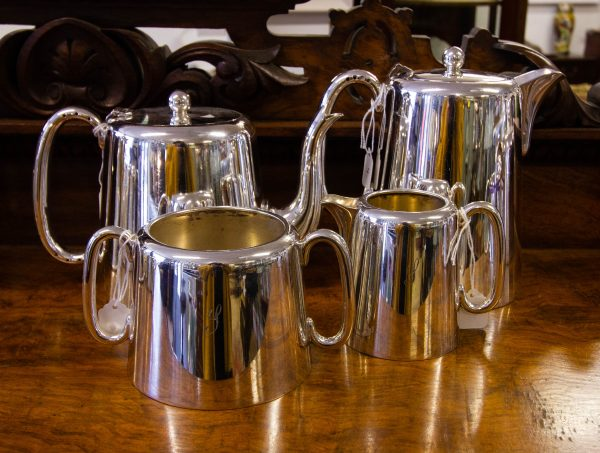 Four piece hotelware silver plated tea and coffee set. 2 pint tea pot, 2 pint coffee/hot water pot. Set includes milk jug and sugar bowl, which are engraved as photographed. Price includes nationwide delivery.