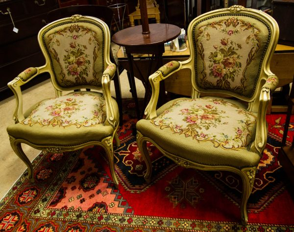 Pair of French painted elbow chairs with tapestry seats, arms and back. Measures 62W x 52D x 86H in cm each. Price includes nationwide delivery