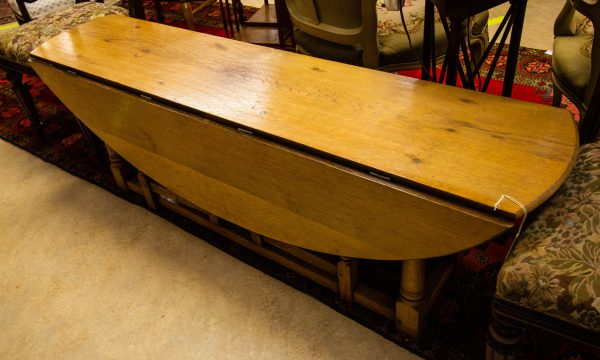 Large oak drop side coffee table. Measures 147L x 36W + 32 each leaf x 50H in cm. Price includes nationwide delivery