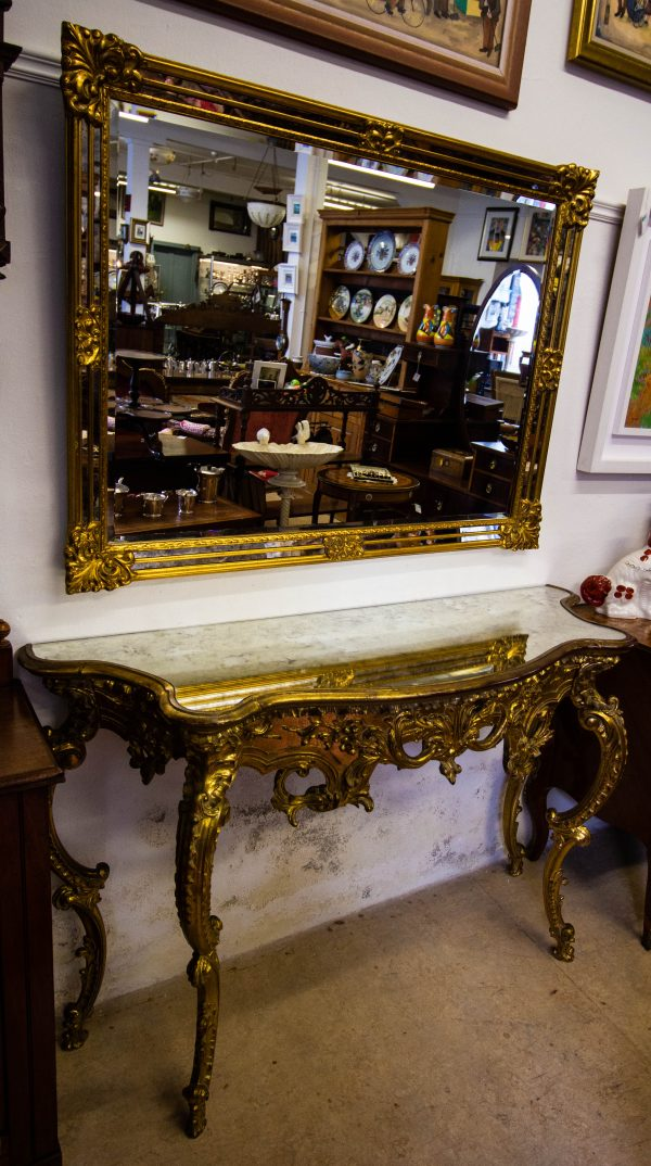 Gilt console table with mirror top and bevelled gilt hall mirror. Selling together. Table measures 139W x 48D x 83H, mirror measures 120W x 90H in cm. Price includes nationwide delivery